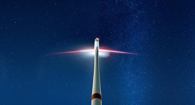 Latest Green Technology Changing The World, Modern Wind Turbine Lit In A Dark Sky