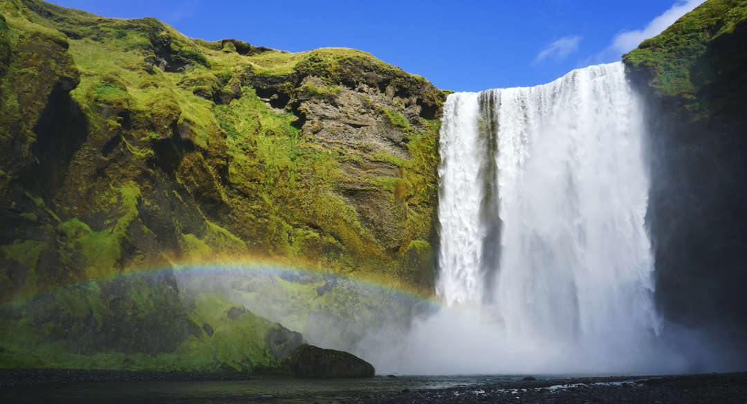 waterfall mist with rainbow, symbolizing best non-comedogenic oils