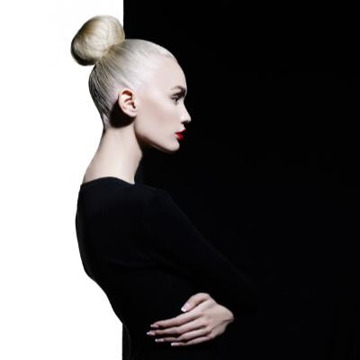 pale, blond model wearing black