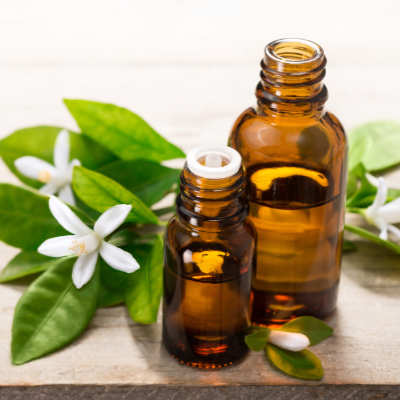 neroli flowers and essential oil